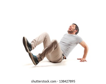 frightened man sitting on the floor