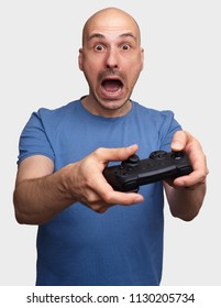 frightened middle aged man playing video game. Isolated on grey