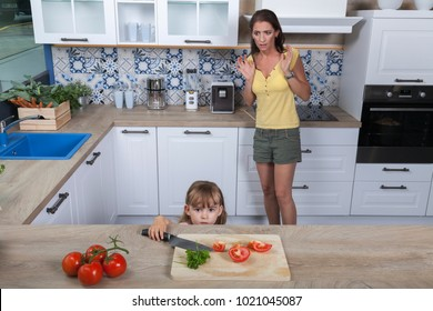 frightened mother realizes that her unattended toddler daughter took a sharp knife from the kitchenette