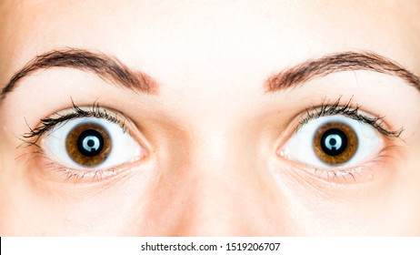 frightened, shocked, scared woman brown eyes closeup