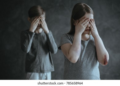 Frightened siblings crying. Children from pathological family