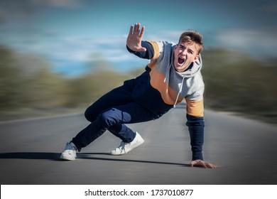 Frightened terrified scared man fall, screaming. Accident, scene on road, highway. Pedestrian boy going to be hitted, downed, bring down by auto. Guy lying on road, asphault show stop sign with palm