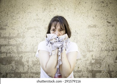 Frightened woman in fear and hands tied