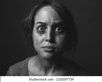 Frightened woman with smeared make up.