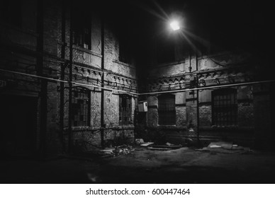 frightening abandoned factory at night in black and white