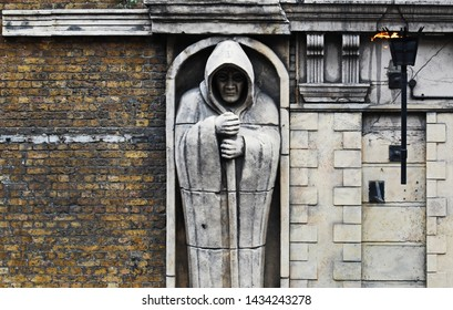 Frightening statue outside the London Dungeon, London, UK
