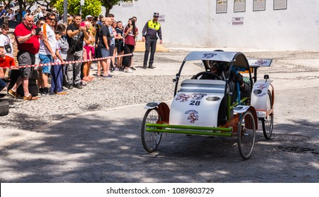 """FRIGILIANA, SPAIN - MAY 13, 2018 """"Autos Locos"""" - traditional fun involving the ride of cardboard cars in small spanish town, self-made vehicles, creative and cheerful event"""