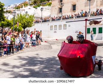 """FRIGILIANA, SPAIN - MAY 13, 2018 """"Autos Locos""""  traditional fun involving the ride of cardboard cars in small spanish town, self-made vehicles, creative and cheerful event"""