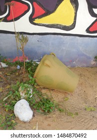 Friguia Park, Bouficha city, Tunisia - July 16, 2019: A jug on the sand against the wall at the zoo in Tunisia.