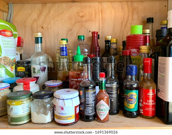 Frilford, Oxfordshire / U.K. - April 2 2020: Pantry shelf with condiments.