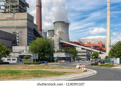 Frimmersdorf, Germany - June 27 2018: Workers leaving factory gate of coal fired power plant Frimmersdorf in Germany