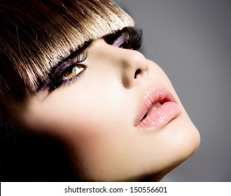 Fringe. Fashion Model Girl With Trendy Hairstyle and Makeup closeup. Haircut. Stylish Beauty Brunette Woman Face. Beautiful Make up. Vogue Style. Hair cut.