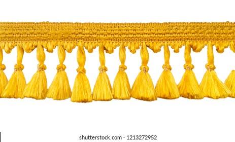 Fringe. Yellow braid with tassels. Isolated on white background.