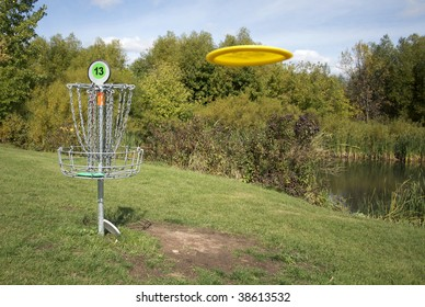 A frisbee golf target with a disc inbound