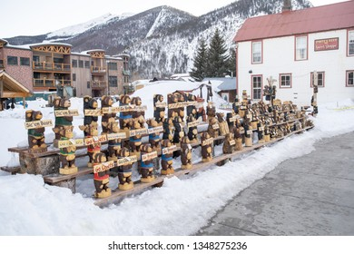 Frisco, Colorado / USA - March 19, 2019: Wooden bears on display by local merchant on downtown Frisco sidewalk.