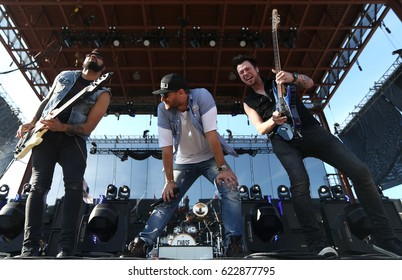 FRISCO, TX-APR 24: (L-R) Marcello Kravitz, Chase Rice and Chris Loocke perform onstage during the 2016 Off The Rails Music Festival - Day 2 on April 24, 2016 at Toyota Stadium in Frisco, Texas.