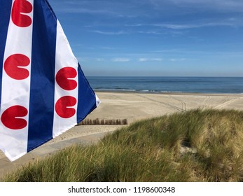 Frisian flag at the beach on Ameland island in Friesland The Netherlands