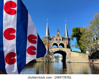 Frisian flag in front of the watergate in Sneek, Friesland The Netherlands