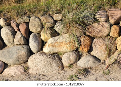 Frisian stone wall on the island of Sylt in the evening light