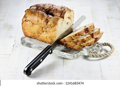 Frisian Suikerbrood (sugar bread) with knife on glass plate