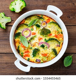 Frittata or casserole with broccoli and vegetables in baking dish. Vegetarian recipe.