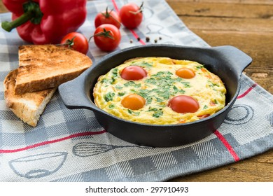 Frittata (italian omelet) with paprika and cherriy tomatoes.