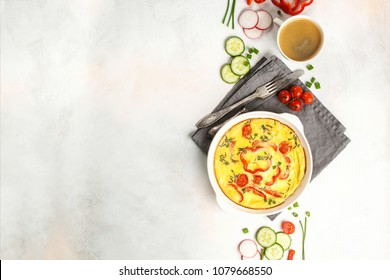 Frittata with paprika and tomatoes. An egg omelet with vegetables. Dietary breakfast. Top view