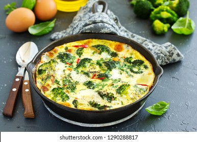 Frittata with vegetables and broccoli. View from above. Selective focus.