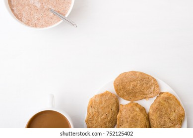 Fritters, coffee and flax-seed porridge on white