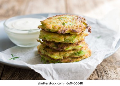 Fritters from courgettes (zucchini). Vegetable vegetarian cutlets or fritters.