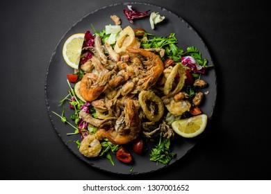 frittura di mare Itali food shrimps sea food squid lemon sardine mussels restaurant Sicilian cuisine