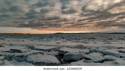 Frobisher Bay in Iqaluit Nunavut at low tide just after the ice has formed in early November.