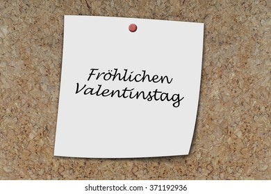 Froehlicher valentinstag (German happy valentines day) written on a memo pinned on a cork board