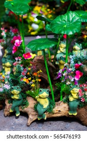 Frog clay dolls on timber for garden decor