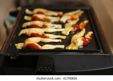 frog legs on grill
