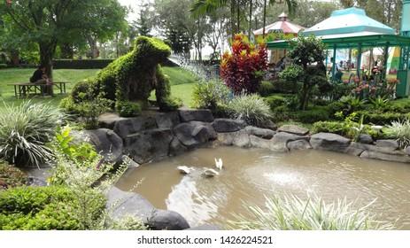frog shape water fountain in nusantara flower garden in cisarua, west java, indonesia. photo taken in june 2019