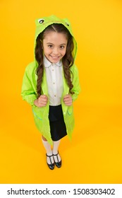 Frog style. Schoolgirl hooded raincoat enjoy fall weather. Rainproof accessories make rainy fall day pleasant. Waterproof accessory. Kid girl happy wear raincoat. Cute raincoat kids would love.
