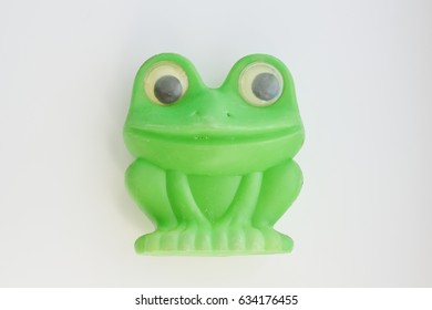 frog toy on white background