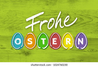 Frohe Ostern (in german happy easter) with colorful eggs on green wood.