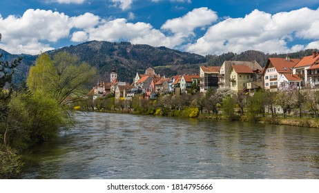 Frohnleiten - small town above Mur river in Styria, Austria. View at Parish church, town and river Mur. Famous travel destination.