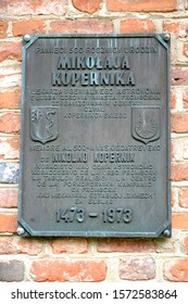 FROMBORK, POLAND - JULY 09, 2015: Memorial plaque commemorating the 500th anniversary of the birth of Nikolai Copernicus (1473-1973). Polish text - 500 years since the birth of Nikolai Copernicus