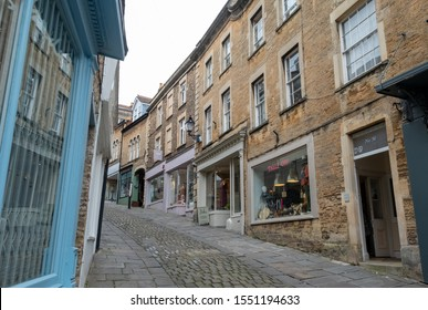 Frome, Somerset. October 2019. Independent shops situated on a steep gradient on Catherine Hill in Frome town centre.
