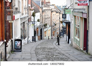 Frome, UK - January 5, 2017: View of a picturesque shopping street in the town centre. The Somerset town near the historic City of Bath has been named by the Times as the 6th Coolest Town in Britain.