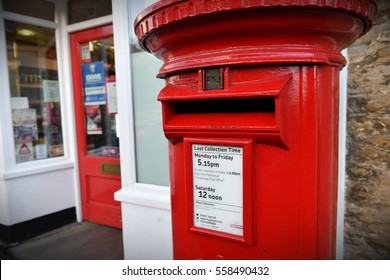 Frome, UK - January 5, 2017: View of a traditional Royal Mail red pillar box outside a Post Office. Founded in 1516 Royal Mail iconic post boxes are ubiquitous throughout Britain and the Commonwealth.