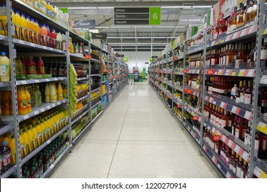 Frome, UK - October 9, 2018: Aisle view of an Asda supermarket. Owned by Walmart since 1999 Asda is the UK's third largest retail chain with 642 stores and an operating income of £792 million in 2016.