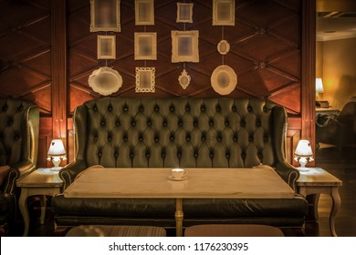 Fron view of green leather sofa in restaurant