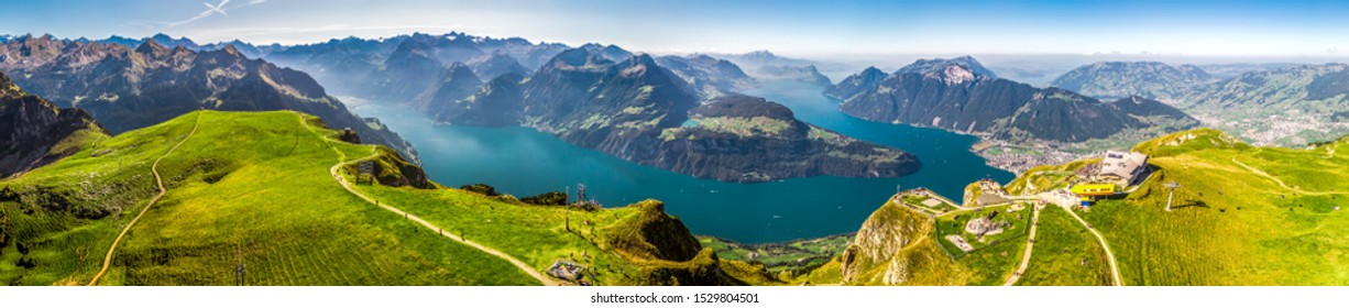 FRONALPSTOCK, SWITZERLAND - August 2019 - Fantastic view to Vierwaldstattersee with Rigi and Pilatus mountains, Brunnen town from Fronalpstock, Switzerland, Europe.
