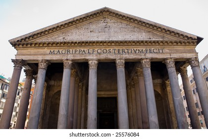 Front of the ancient Parthenon building in Rome, Italy showing the columns and roofline.