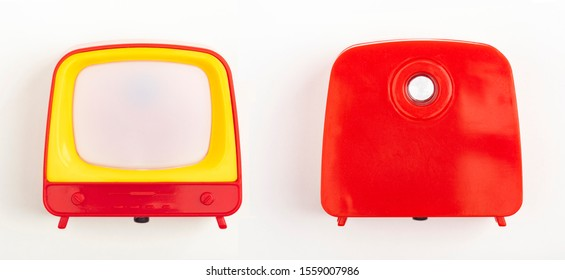 Front and backside from miniature Toy Television on white background
