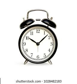 Front of black alarm clock analog classic vintage style. Isolated on white background.